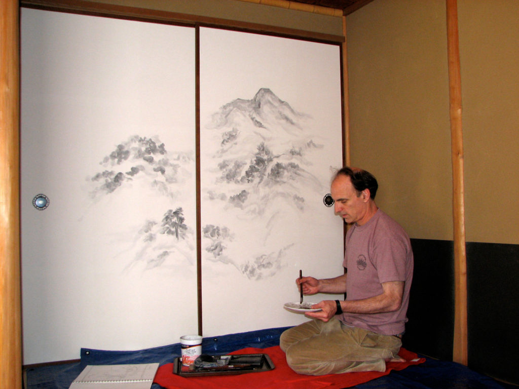 Michael Hofmann painting fusuma screens at Green Gulch Zen Center, Muir Beach, California